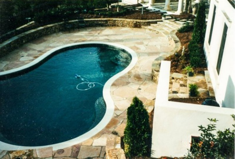 Stone work around swimming pools m i european stucco for Pool show michigan