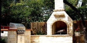 natural-stone-patio-and-outdoor-fireplace-by-archadeck-of-austin